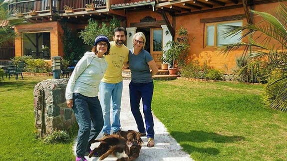 tourists pose with owner and dog at ilatoa lodge hotel quito