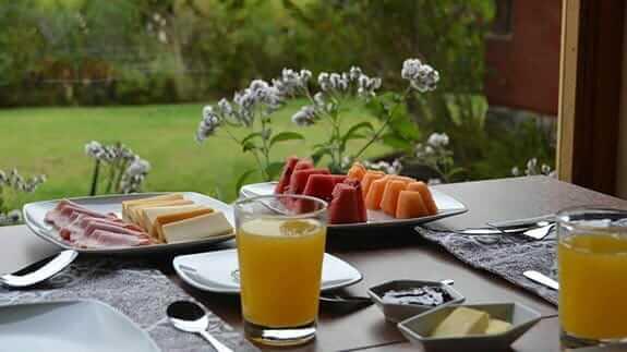 ilatoa lodge hotel quito - breakfast on the balcony
