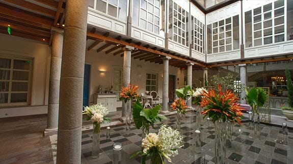 open patio with flowers illa experience hotel quito