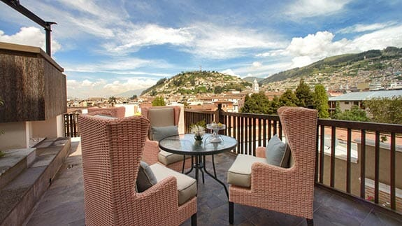 views of quito's panecillo from roof top terrace at illa experience hotel