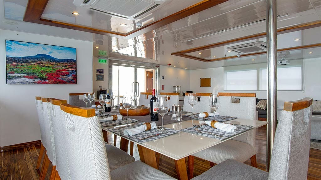 infinity yacht - dining table laid ready for dinner