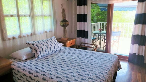 double bedroom with private patio at isabela beach house, puerto villamil, galapagos islands