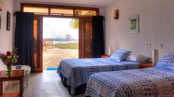 twin bedroom opening onto the beach at isabela beach house, puerto villamil, galapagos islands