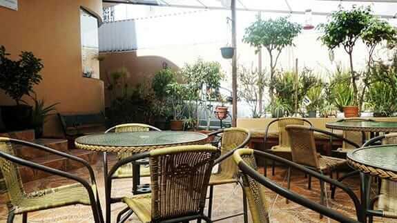 open patio and garden at jhomana hostal quito