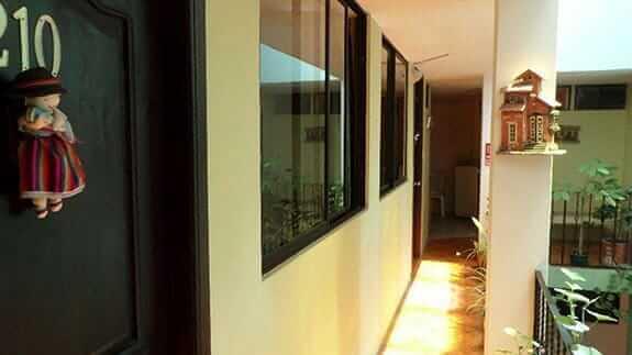 room entrances and walkway at jhomana hostal quito