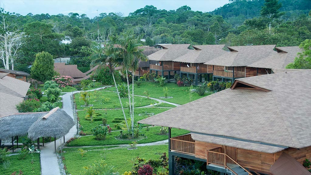 aerial view of cabins and gardens at Casa del suizo jungle lodge