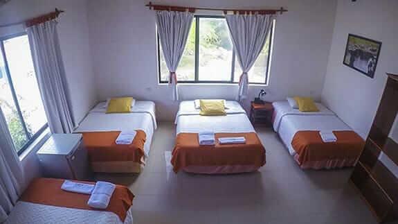 cuadruple bedroom in La Gran Tortuga hotel puerto villamil, isabela, galapagos islands