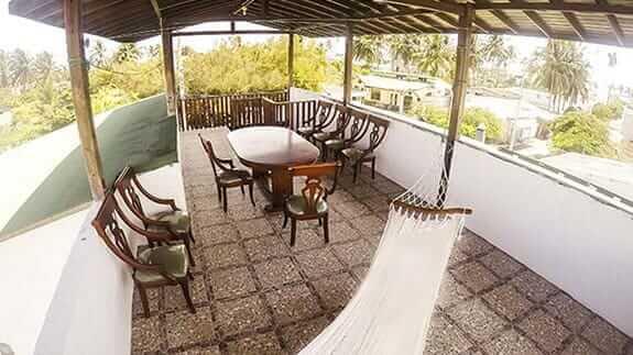 Top floor terrace with hammock and dining table at Gran Tortuga hotel puerto villamil, isabela, galapagos islands