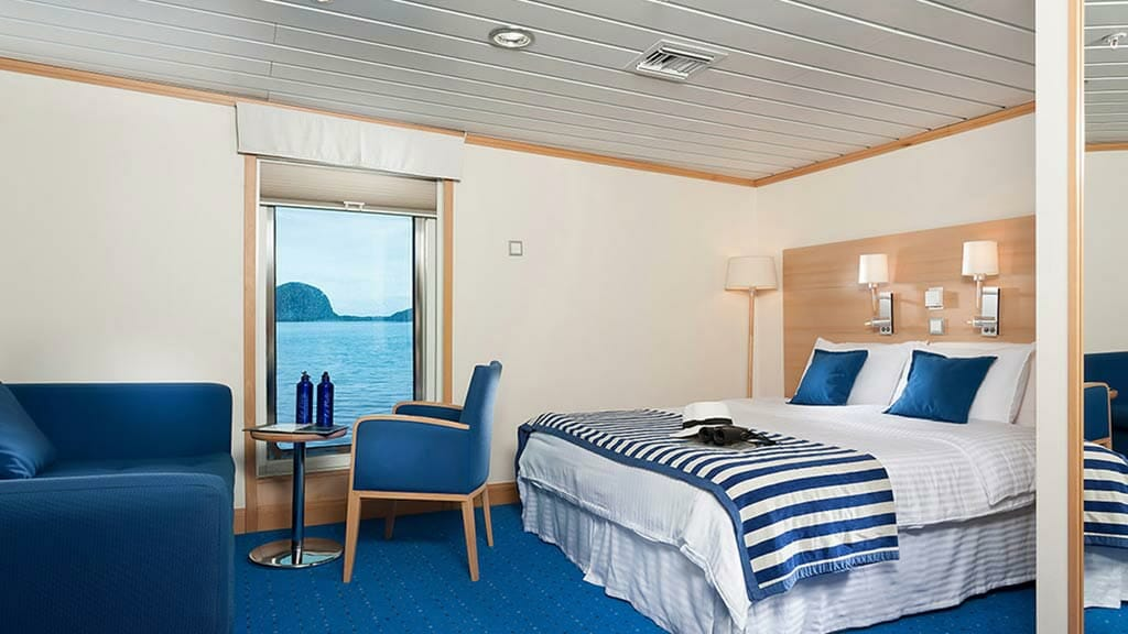 double bed cabin with large window views aboard La Pinta ship