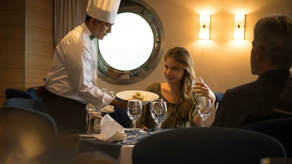 chef serving up fine dining to tourists aboard La Pinta Galapagos ship