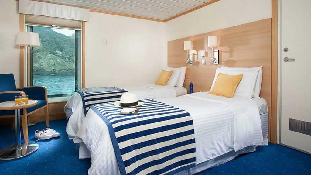 twin bed cabin with large window views aboard La Pinta ship