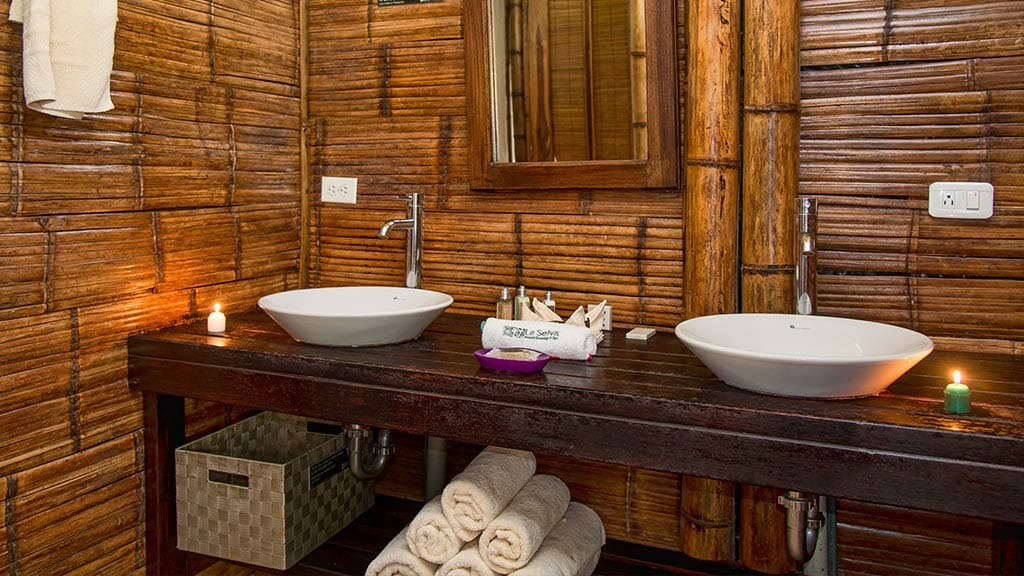 La Selva lodge ecuador guest cabni bathroom with twin wash basins and towels