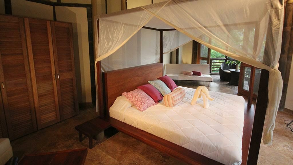 double bedroom cabin with mosquito nets at La Selva ecuador