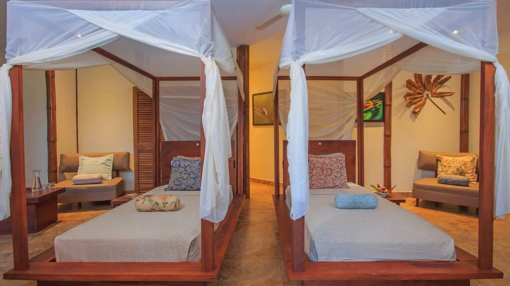 twin bedroom cabin with mosquito nets at La Selva jungle lodge Coca Ecuador