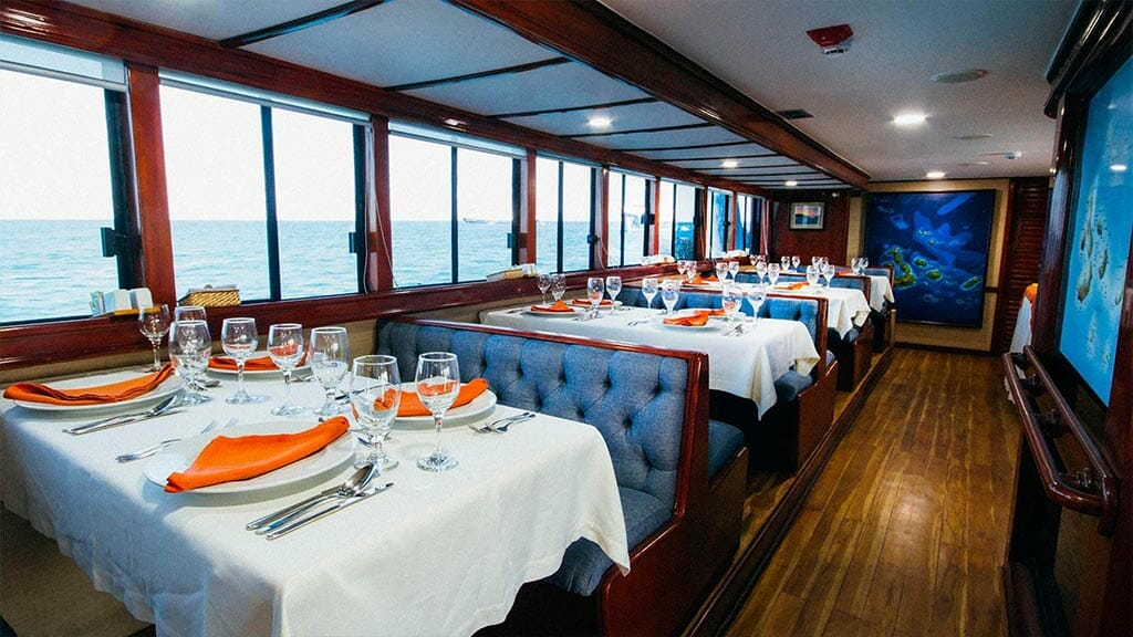 Letty yacht Galapagos - dining tables ready for dinner with ocean views