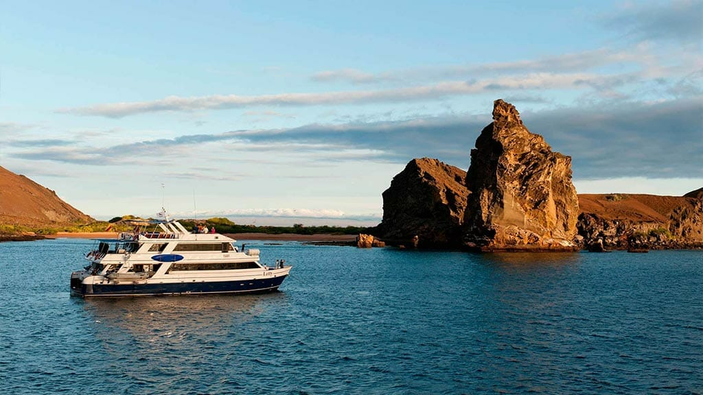 Letty yacht Galapagos cruise - side on view of the yacht anchored by pinnacle rock Bartolome