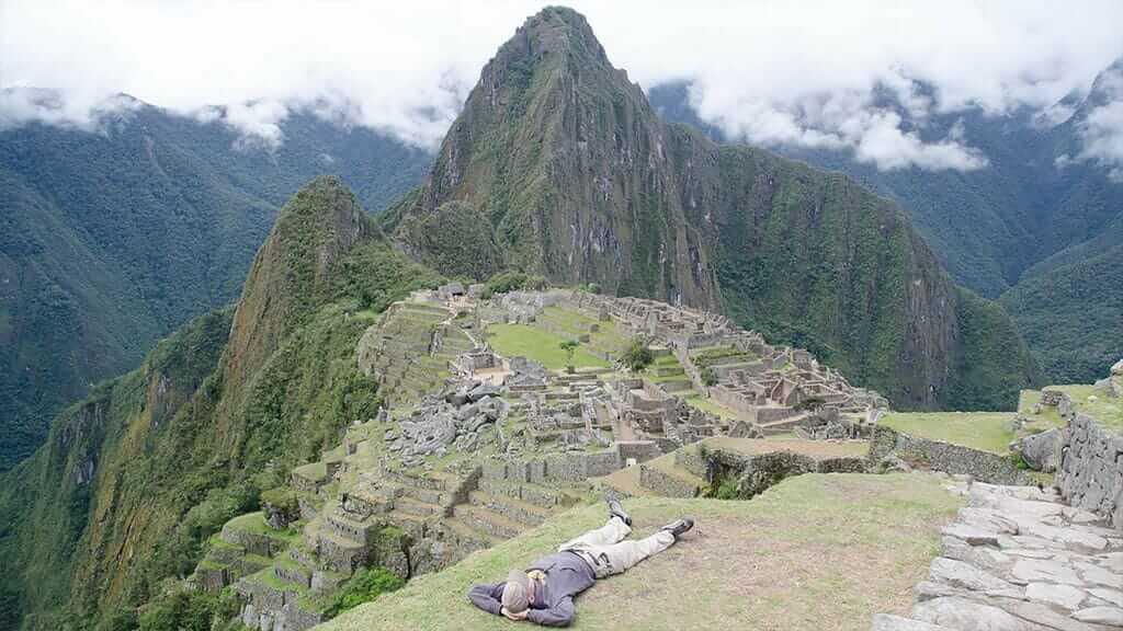 tourist taking siests at machu picchu peru