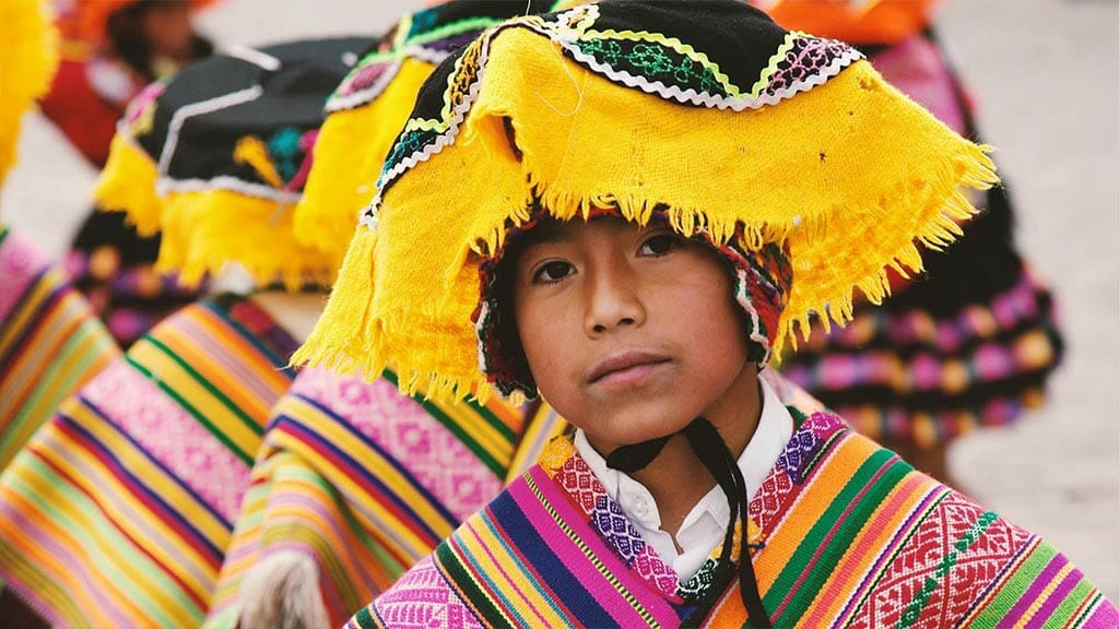 young peruvian indian boy in colorful poncho and hat