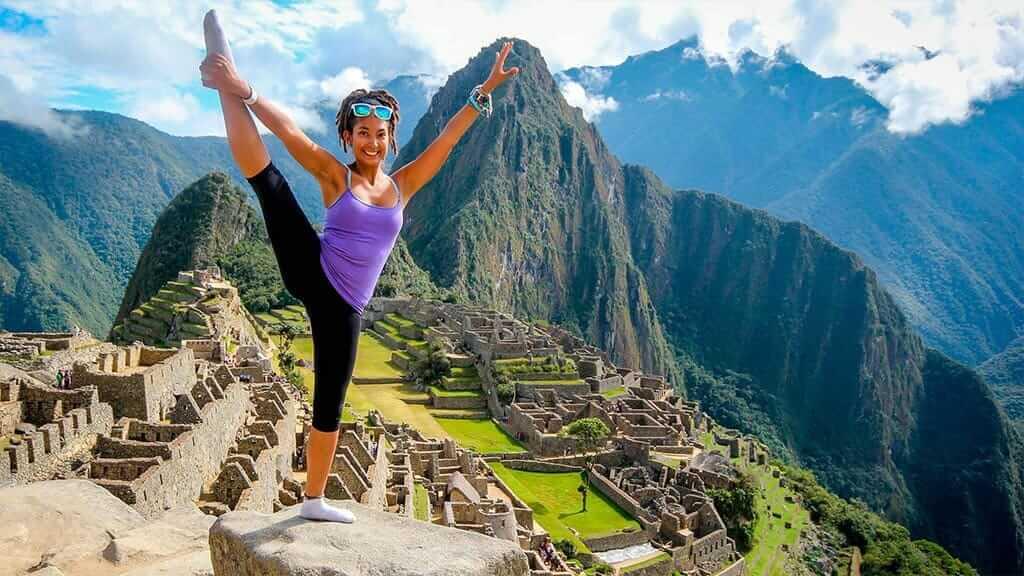 girl does yoga pose at machu picchu
