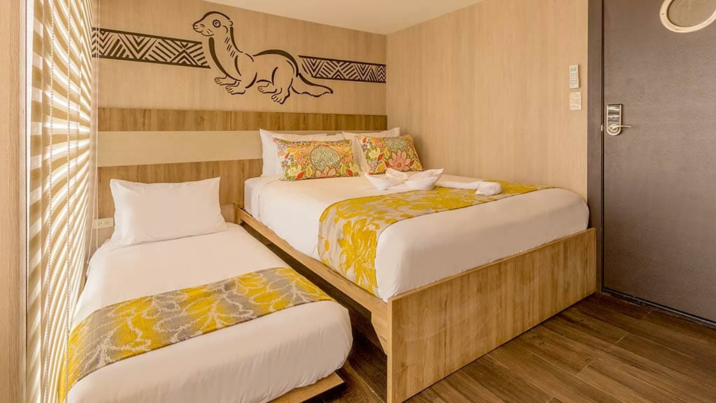 double bed room with extra bed aboard the Manatee Explorer Cruise ship Ecuador