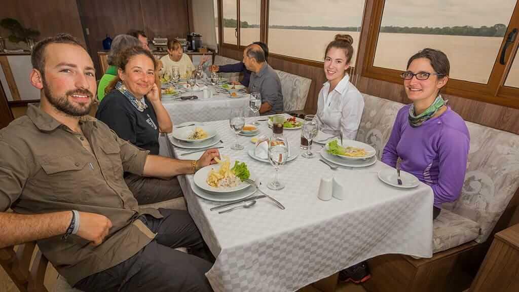 guests enjoy dinner in the Manatee amazon explorer restaurant