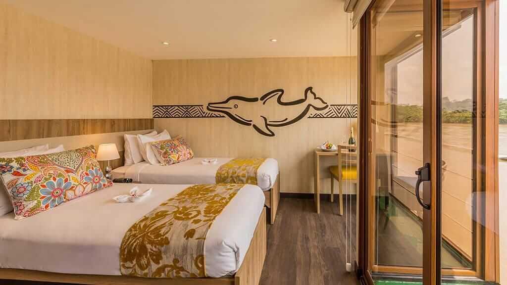 twin bed room with balcony aboard the Manatee Explorer Cruise ship Ecuador