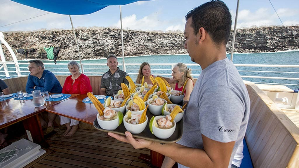 Mary Anne Galapagos yacht - lunch time at the alfresco dining area, ceviche is served