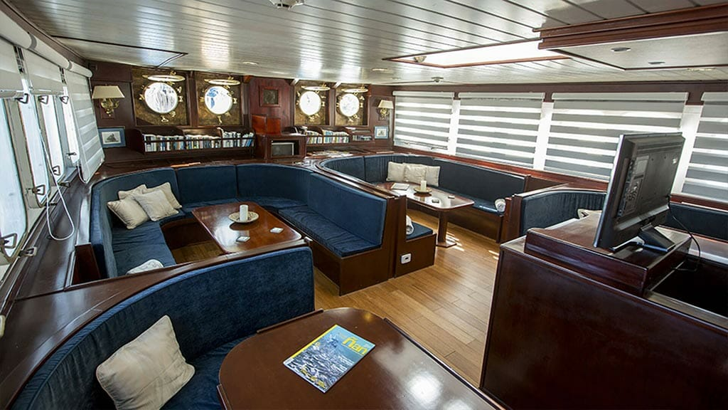 Mary Anne Galapagos cruise - indoor social lounge area with tv