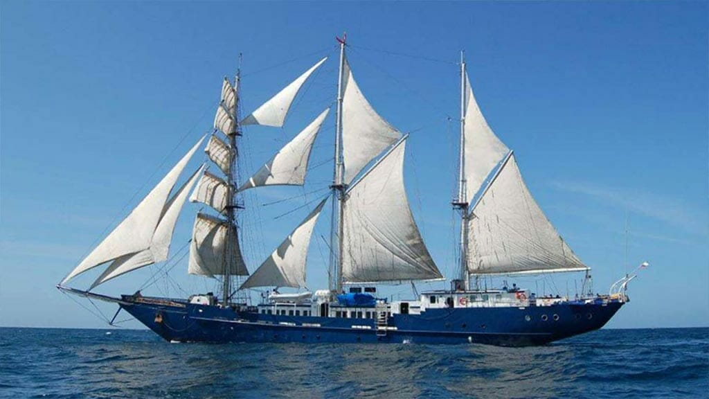 side view of the impressive mary anne yacht cruising at the Galapagos islands