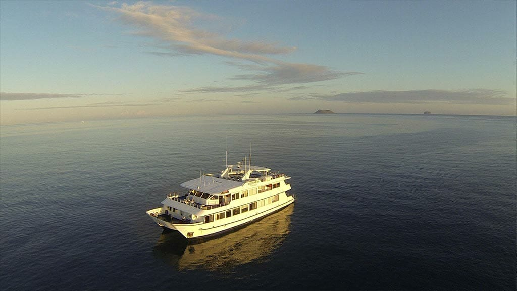 The Millenium catamaran Galapagos yacht cruising on a calm ocean