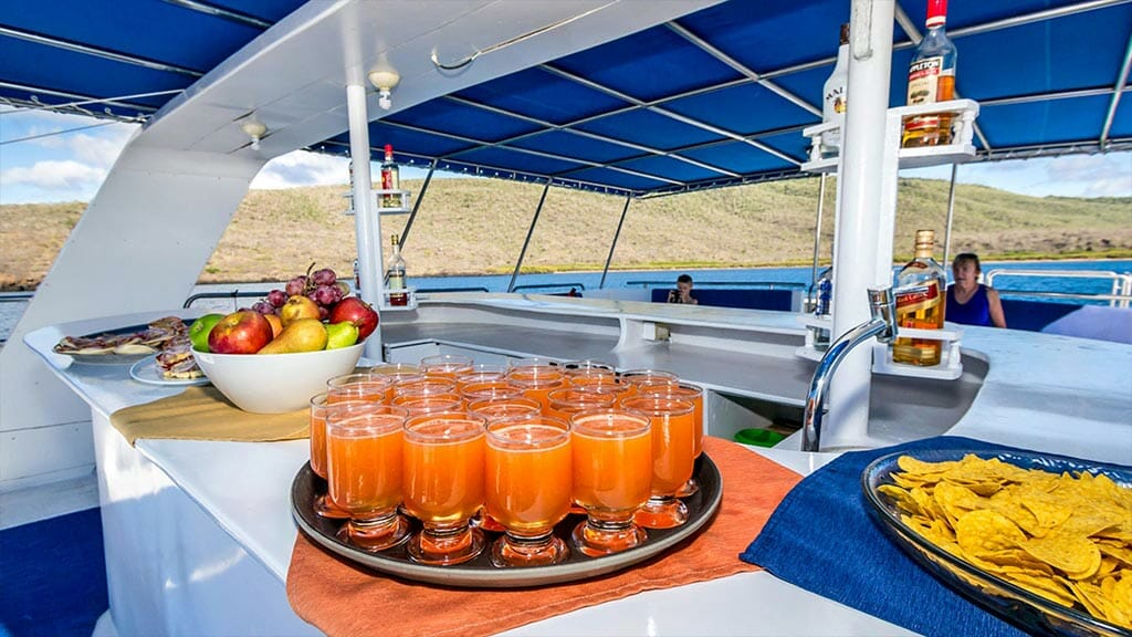 Monserrat yacht galapagos cruise - fruit juice and snacks served at the outside bar