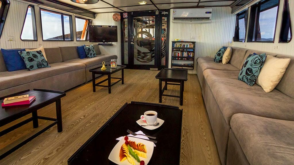 Monserrat yacht galapagos cruise - indoor lounge area and library