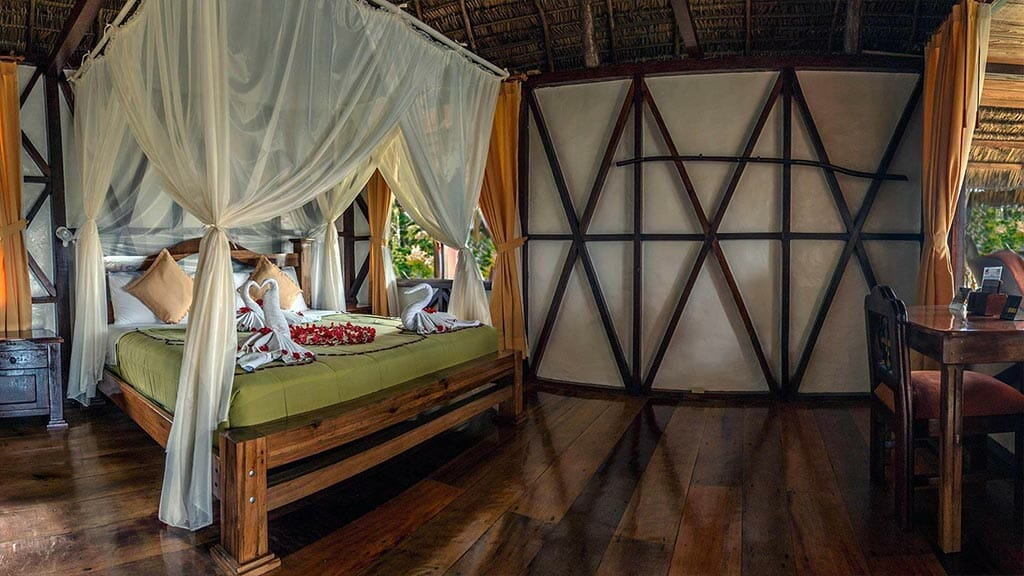 napo wildlife center lodge double bed guest cabin with mosquito net