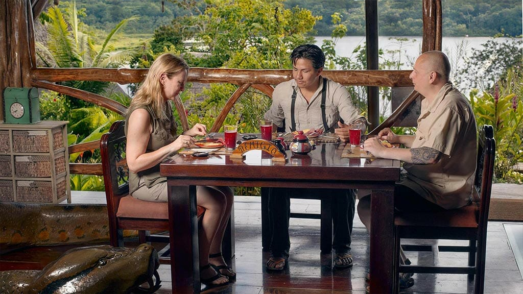 tourists enjoy lunch with their guide at the napo wildlife center lodge restaurant
