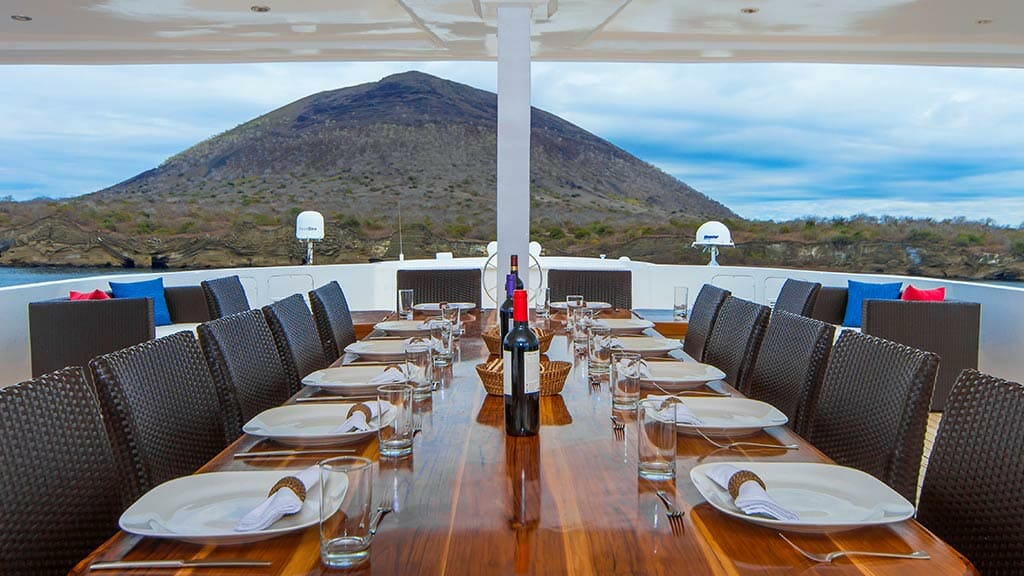 Natural Paradise Galapagos cruise - alfresco dining with island and ocean views