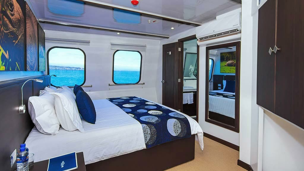 double bed guest cabin aboard the Natural Paradise yacht Galapagos cruise