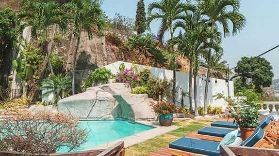 iguanazu hotel swimming pool and sun loungers
