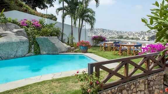 iguanazu hotel swimming pool area and coffee tables