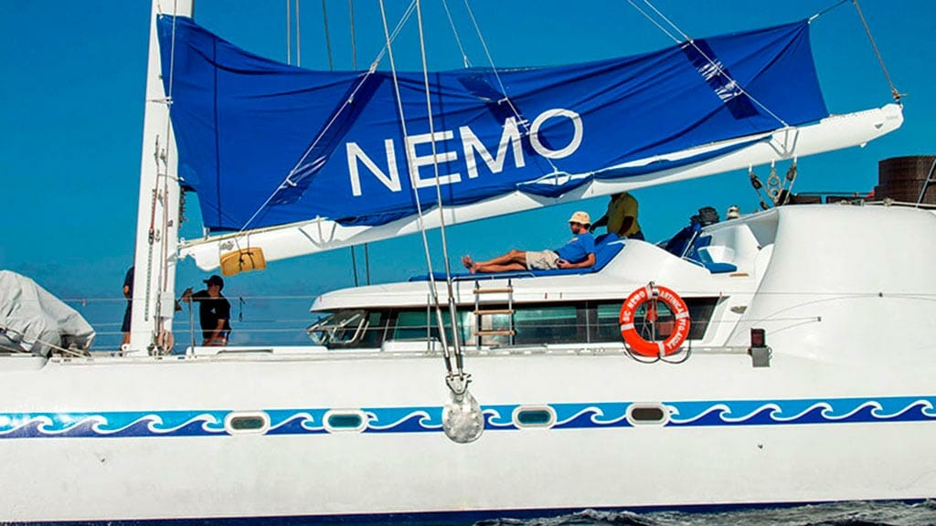 nemo 1 yacht galapagos cruise - tourists relaxing on sundeck