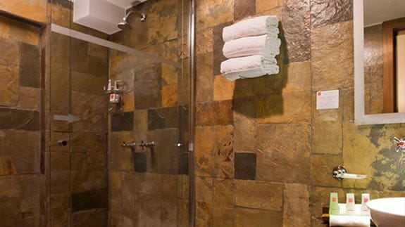 nu house hotel quito - guest bathroom and shower