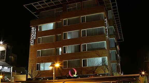 nu house hotel facade illuminated at night in quito