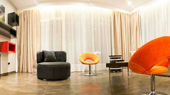 lounge with modern furniture at nu house hotel