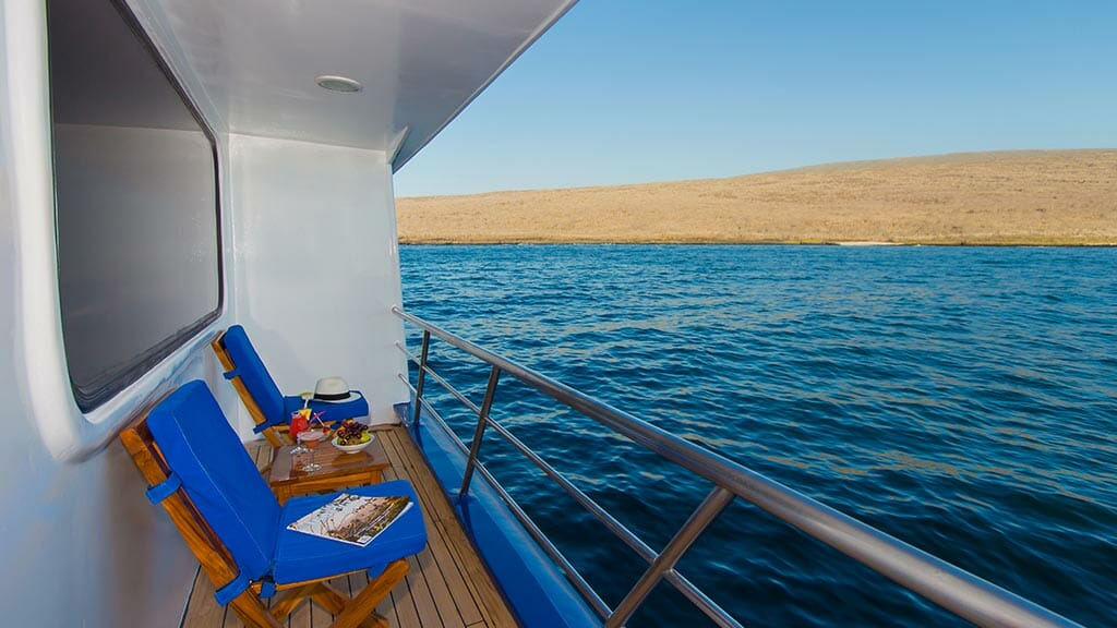 ocean spray yacht private guest cabin balcony with galapagos ocean views
