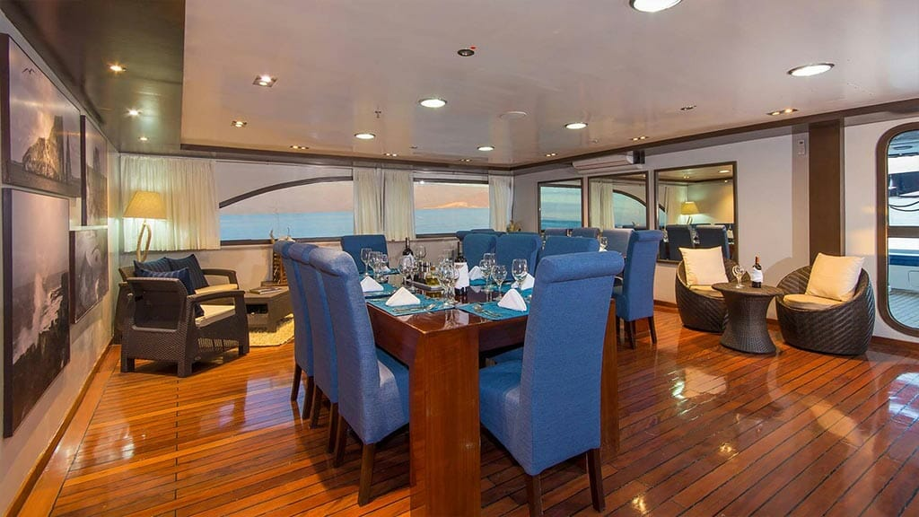 dining room of the ocean spray galapagos catamaran yacht
