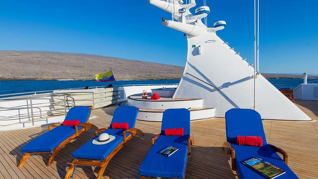 blue comfy loungers on the ocean spray galapagos cruise sundeck