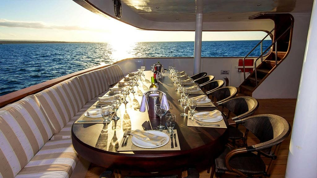 Odyssey yacht galapagos islands - open air dining at sunset