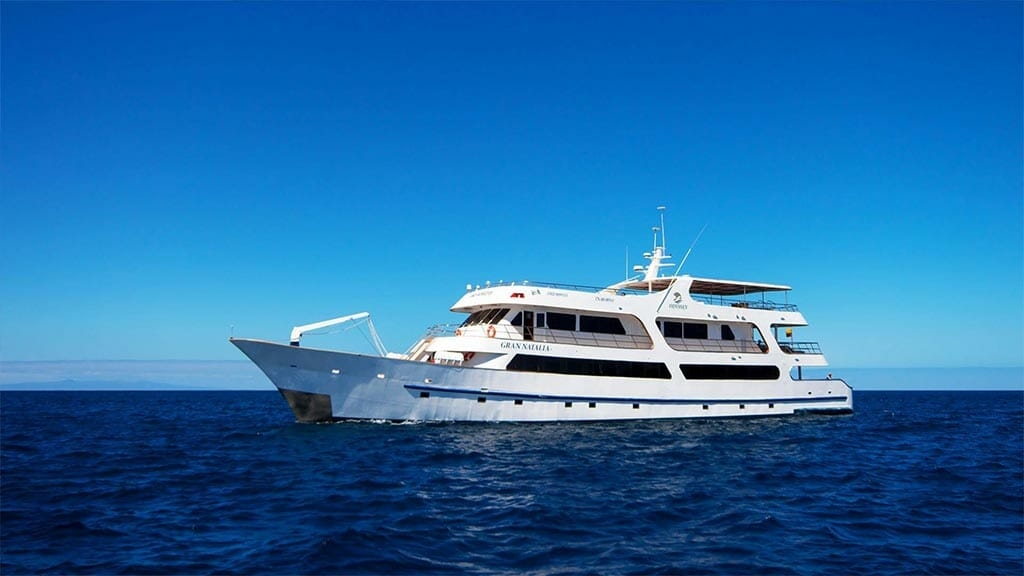 side view of the Odyssey yacht at Galapagos with blue sky