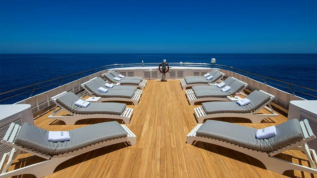 Odyssey Galapagos cruise - wooden decked sundeck with loungers and panoramic 360 degree views