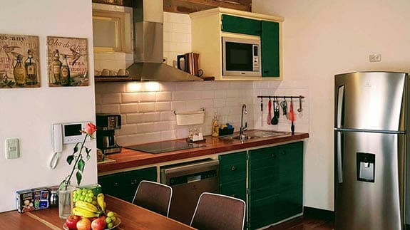 fully equipped kitchen for guests use at old town quito suites