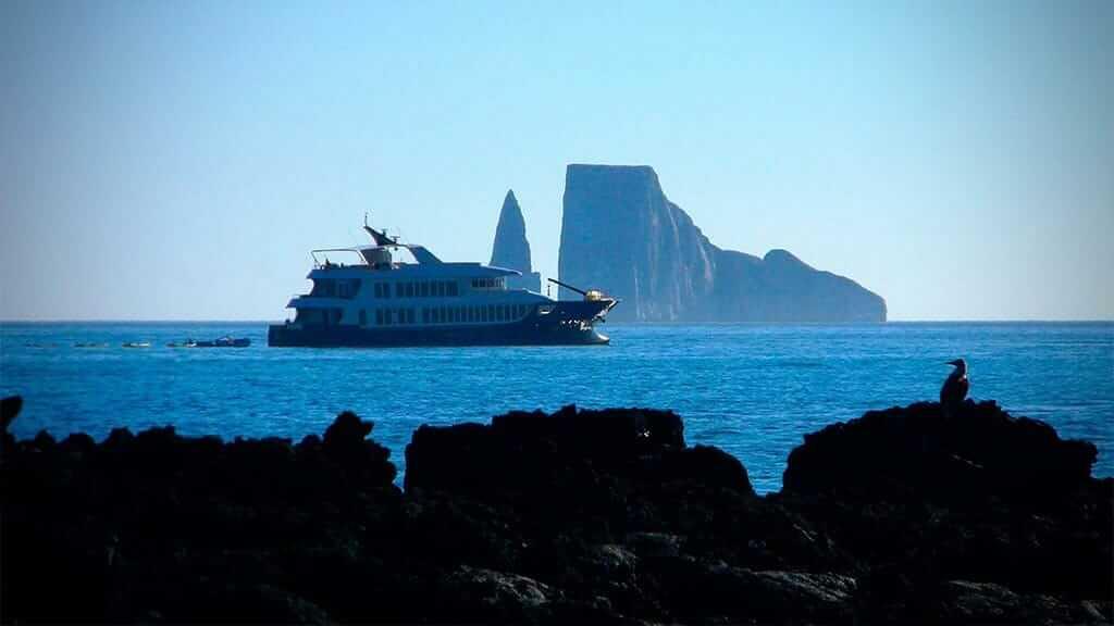 Origin yacht anchored at kicker rock galapagos islands